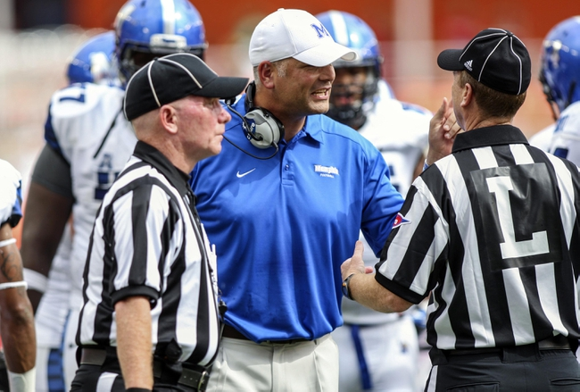 Oct 12, 2013; Houston, TX, USA; Memphis Tigers head coach Justin Fuente discusses a call with officials during the first quarter against the Houston Cougars at BBVA Compass Stadium. Mandatory Credit: Troy Taormina-USA TODAY Sports