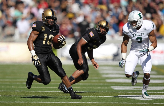 Oct 12, 2013; West Point, NY, USA; Army Black Knights running back Trenton Turrentine (10) rushes the ball past Eastern Michigan Eagles defensive back Donald Coleman (3) during the first half at Michie Stadium. Mandatory Credit: Danny Wild-USA TODAY Sports