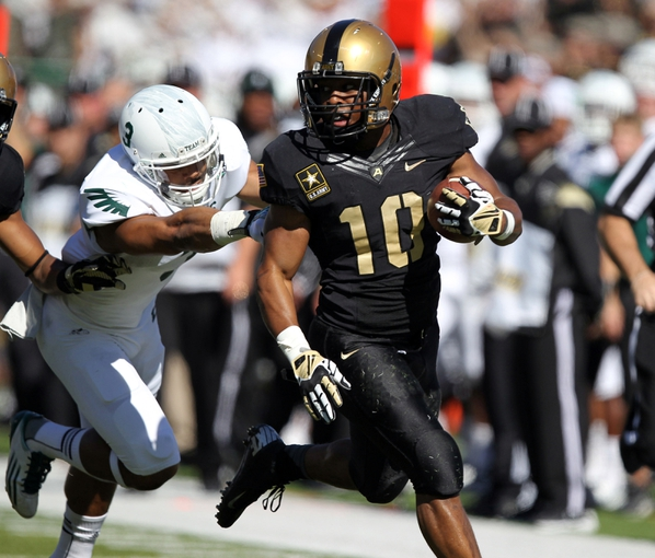 Oct 12, 2013; West Point, NY, USA; Army Black Knights running back Trenton Turrentine (10) runs by Eastern Michigan Eagles defensive back Donald Coleman (3) during the first half at Michie Stadium. Mandatory Credit: Danny Wild-USA TODAY Sports