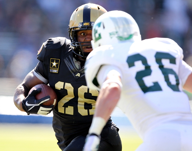 Oct 12, 2013; West Point, NY, USA; Army Black Knights running back Larry Dixon (26) rushes the ball against Eastern Michigan Eagles defensive back Mycal Swaim (26) during the first half at Michie Stadium. Mandatory Credit: Danny Wild-USA TODAY Sports