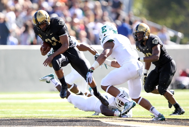 Oct 12, 2013; West Point, NY, USA; Army Black Knights running back Terry Baggett (31) rushes the ball during the first half against the Eastern Michigan Eagles at Michie Stadium. Mandatory Credit: Danny Wild-USA TODAY Sports