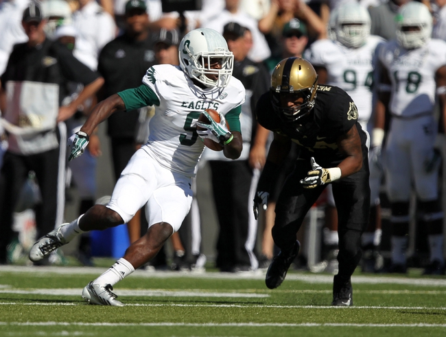Oct 12, 2013; West Point, NY, USA; Eastern Michigan Eagles wide receiver Jay Jones (9) runs past Army Black Knights defensive back Chris Carnegie (14) during the first half at Michie Stadium. Mandatory Credit: Danny Wild-USA TODAY Sports