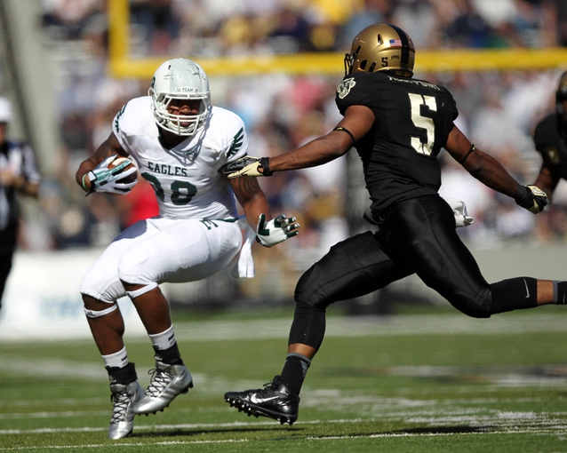 Oct 12, 2013; West Point, NY, USA; Eastern Michigan Eagles running back Bronson Hill (30) runs against Army Black Knights linebacker Justin Trimble (5) during the first half at Michie Stadium. Mandatory Credit: Danny Wild-USA TODAY Sports