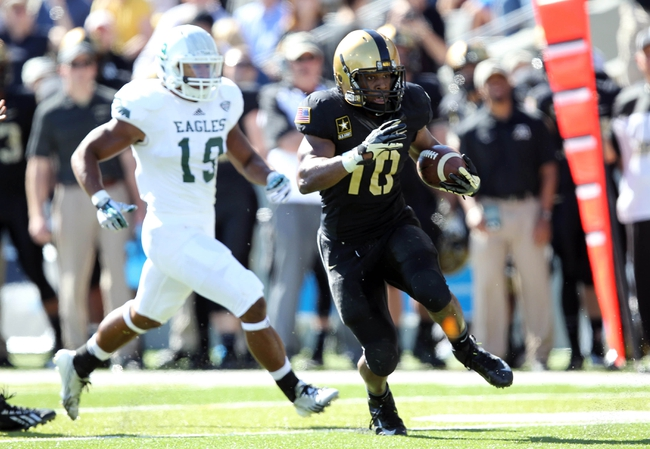 Oct 12, 2013; West Point, NY, USA; Army Black Knights running back Trenton Turrentine (10) rushes the ball during the first half against the Eastern Michigan Eagles at Michie Stadium. Mandatory Credit: Danny Wild-USA TODAY Sports