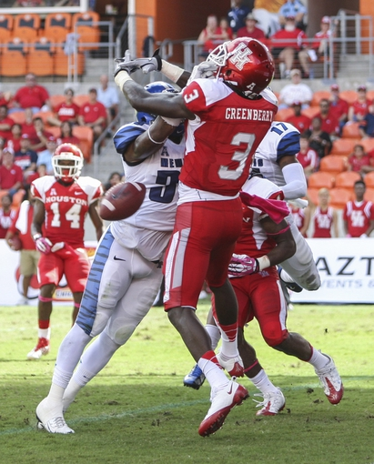 Oct 12, 2013; Houston, TX, USA; Houston Cougars wide receiver Deontay Greenberry (3) attempts to catch a pass during the second quarter against the Memphis Tigers at BBVA Compass Stadium. Mandatory Credit: Troy Taormina-USA TODAY Sports