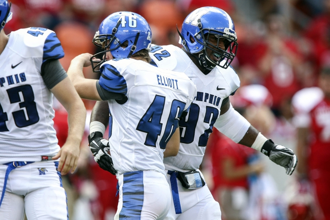 Oct 12, 2013; Houston, TX, USA; Memphis Tigers kicker Jake Elliott (46) is congratulated by defensive lineman Melvin Jones (92) after making a field goal during the second quarter against the Houston Cougars at BBVA Compass Stadium. Mandatory Credit: Troy Taormina-USA TODAY Sports
