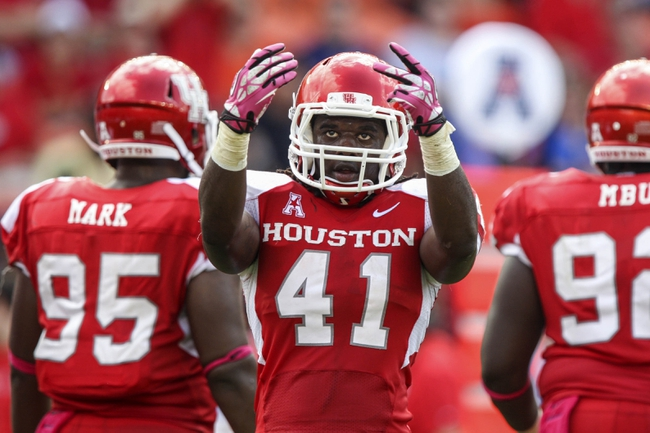 Oct 12, 2013; Houston, TX, USA; Houston Cougars linebacker Steven Taylor (41) motions to the crowd during the second quarter against the Memphis Tigers at BBVA Compass Stadium. Mandatory Credit: Troy Taormina-USA TODAY Sports