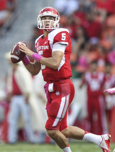 Oct 12, 2013; Houston, TX, USA; Houston Cougars quarterback John O'Korn (5) looks for an open receiver during the second quarter against the Memphis Tigers at BBVA Compass Stadium. Mandatory Credit: Troy Taormina-USA TODAY Sports