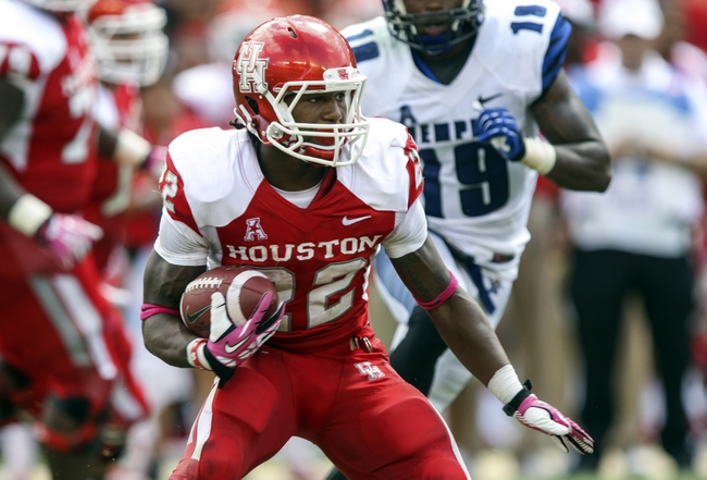 Oct 12, 2013; Houston, TX, USA; Houston Cougars running back Ryan Jackson (22) rushes during the second quarter against the Memphis Tigers at BBVA Compass Stadium. Mandatory Credit: Troy Taormina-USA TODAY Sports