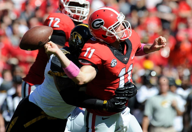Oct 12, 2013; Athens, GA, USA; Georgia Bulldogs quarterback Aaron Murray (11) is sacked and fumbles after being hit by Missouri Tigers defensive lineman Shane Ray (56) during the second quarter at Sanford Stadium. Mandatory Credit: Dale Zanine-USA TODAY Sports