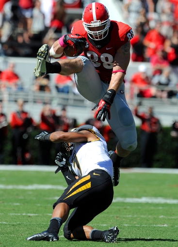 Oct 12, 2013; Athens, GA, USA; Georgia Bulldogs tight end Arthur Lynch (88) jumps over top of Missouri Tigers defensive back Randy Ponder (7) during the second quarter at Sanford Stadium. Mandatory Credit: Dale Zanine-USA TODAY Sports