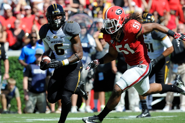 Oct 12, 2013; Athens, GA, USA; Missouri Tigers running back Marcus Murphy (6) runs for a touchdown past Georgia Bulldogs linebacker Ramik Wilson (51) during the second quarter at Sanford Stadium. Mandatory Credit: Dale Zanine-USA TODAY Sports