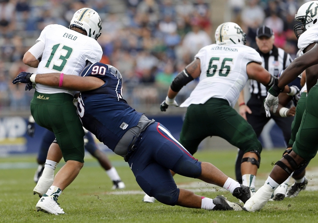 Oct 12, 2013; East Hartford, CT, USA; South Florida Bulls quarterback Bobby Eveld (13) is sacked by Connecticut Huskies defensive tackle Julian Campenni (90) in the second quarter at Rentschler Field. Mandatory Credit: David Butler II-USA TODAY Sports