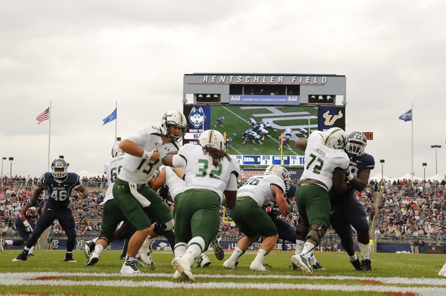 Oct 12, 2013; East Hartford, CT, USA; South Florida Bulls quarterback Bobby Eveld (13) hands off the ball to running back Willie Davis (32) as they take on the Connecticut Huskies in the second quarter at Rentschler Field. Mandatory Credit: David Butler II-USA TODAY Sports