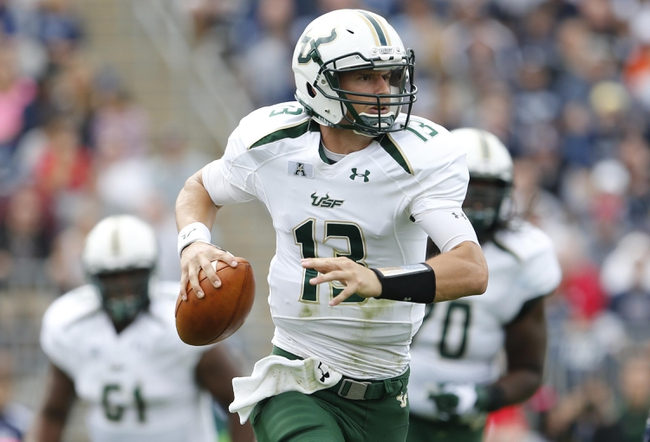 Oct 12, 2013; East Hartford, CT, USA; South Florida Bulls quarterback Bobby Eveld (13) looks to throw a pass against the Connecticut Huskies in the second quarter at Rentschler Field. Mandatory Credit: David Butler II-USA TODAY Sports