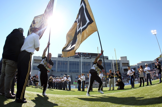 Oct 12, 2013; West Point, NY, USA; Army Black Knights cheerleaders take the field with flags before the game against the Eastern Michigan Eagles at Michie Stadium. Mandatory Credit: Danny Wild-USA TODAY Sports
