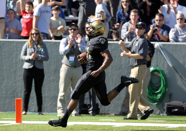 Oct 12, 2013; West Point, NY, USA; Army Black Knights running back Terry Baggett (31) scores a touchdown during the first half against the Eastern Michigan Eagles at Michie Stadium. Mandatory Credit: Danny Wild-USA TODAY Sports