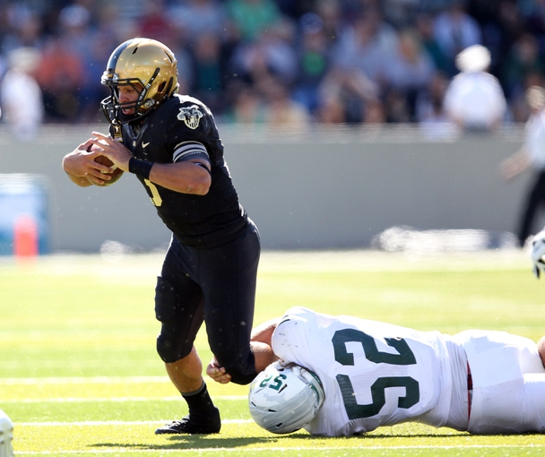 Oct 12, 2013; West Point, NY, USA; Army Black Knights quarterback Angel Santiago (3) is dragged down by Eastern Michigan Eagles defensive lineman Pat O'Connor (52) during the first half at Michie Stadium. Mandatory Credit: Danny Wild-USA TODAY Sports