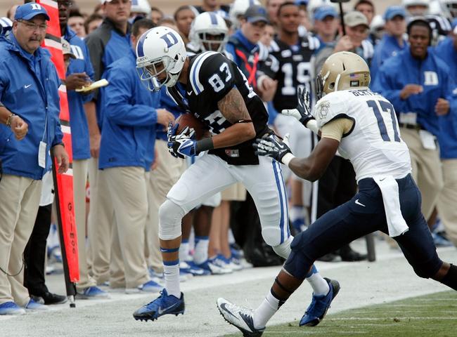 Oct 12, 2013; Durham, NC, USA; Duke Blue Devils wide receiver Anthony Nash (83) is pushed out of bounds by Navy Midshipmen cornerback Kwazel Bertrand (17) at Wallace Wade Stadium. Mandatory Credit: Mark Dolejs-USA TODAY Sports
