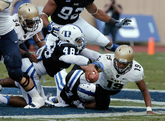 Oct 12, 2013; Durham, NC, USA; Duke Blue Devils linebacker Deion Williams (48) pressures Navy Midshipmen quarterback Keenan Reynolds (19) as he reaches for extra yards in their game at Wallace Wade Stadium. Mandatory Credit: Mark Dolejs-USA TODAY Sports