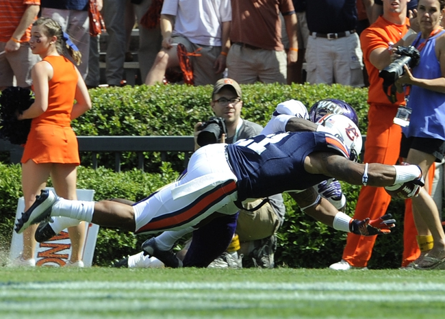 Oct 12, 2013; Auburn, AL, USA; Auburn Tigers running back Tre Mason (21) scores a touchdown in the first quarter against the Western Carolina Catamounts at Jordan Hare Stadium. Mandatory Credit: Shanna Lockwood-USA TODAY Sports