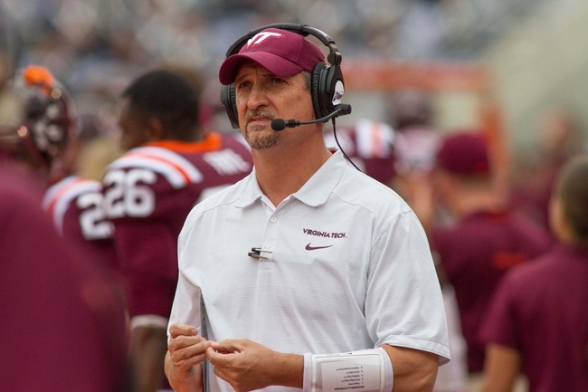 Oct 12, 2013; Blacksburg, VA, USA; Virginia Tech Hokies defensive coordinator Bud Foster stands on the sidelines during the fourth quarter in the game against the Pittsburgh Panthers at Lane Stadium. The Hokies defeated Pitt 19-9. Mandatory Credit: Jeremy Brevard-USA TODAY Sports