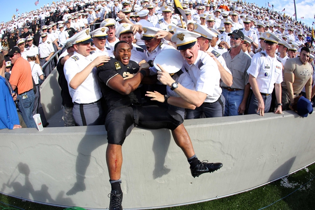 Oct 12, 2013; West Point, NY, USA; Army Black Knights running back Terry Baggett (31) celebrates with cadets after the game against the Eastern Michigan Eagles at Michie Stadium. Mandatory Credit: Danny Wild-USA TODAY Sports