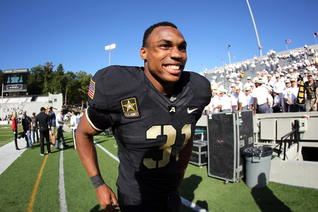 Oct 12, 2013; West Point, NY, USA; Army Black Knights running back Terry Baggett (31) celebrates after the game against the Eastern Michigan Eagles at Michie Stadium. Mandatory Credit: Danny Wild-USA TODAY Sports