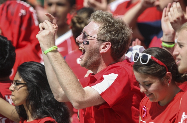 Oct 12, 2013; Houston, TX, USA; Houston Cougars fan Kurt Mayon cheers during the third quarter against the Memphis Tigers at BBVA Compass Stadium. The Cougars defeated the Tigers 25-15. Mandatory Credit: Troy Taormina-USA TODAY Sports