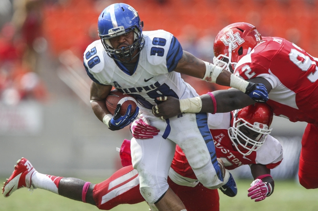 Oct 12, 2013; Houston, TX, USA; Memphis Tigers running back Brandon Hayes (38) runs with the ball during the third quarter as Houston Cougars defensive lineman Joey Mbu (92) and defensive end Trevor Harris (46) attempt to make a tackle at BBVA Compass Stadium. The Cougars defeated the Tigers 25-15. Mandatory Credit: Troy Taormina-USA TODAY Sports
