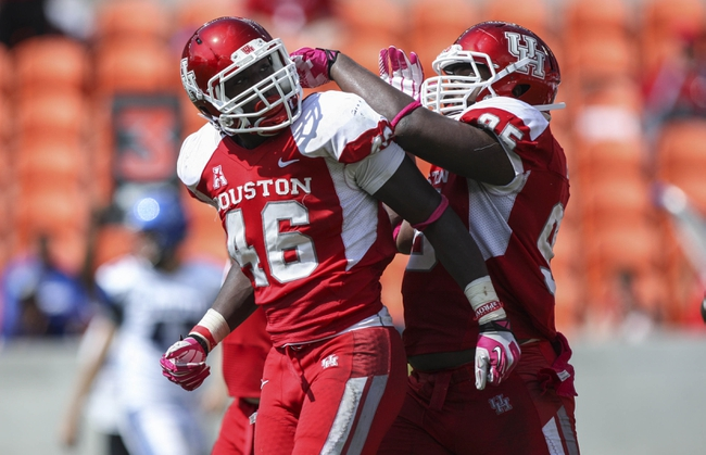 Oct 12, 2013; Houston, TX, USA; Houston Cougars defensive end Trevor Harris (46) is congratulated by defensive lineman Tomme Mark (95) after a defensive play during the fourth quarter against the Memphis Tigers at BBVA Compass Stadium. Mandatory Credit: Troy Taormina-USA TODAY Sports