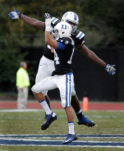 Oct 12, 2013; Durham, NC, USA; Duke Blue Devils nose tackle Carlos Wray (98) celebrates with wide receiver Johndre Bennett (14) after Wray recovered a Navy Midshipmen fumble in the fourth quarter at Wallace Wade Stadium. Mandatory Credit: Mark Dolejs-USA TODAY Sports
