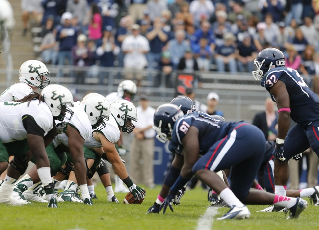 Oct 12, 2013; East Hartford, CT, USA; The South Florida Bulls offense take on the Connecticut Huskies defense in the second half at Rentschler Field. South Florida defeated Connecticut 13-10. Mandatory Credit: David Butler II-USA TODAY Sports