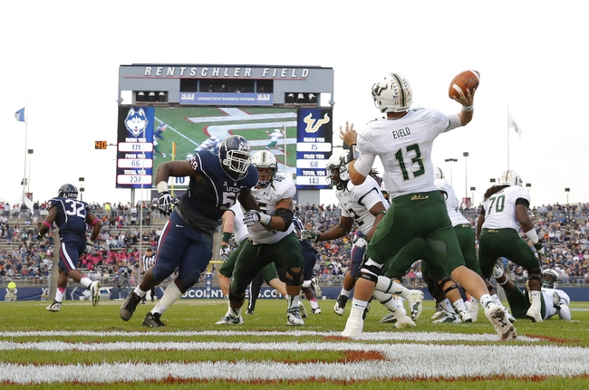 Oct 12, 2013; East Hartford, CT, USA; South Florida Bulls quarterback Bobby Eveld (13) throws a pass against the Connecticut Huskies in the second half at Rentschler Field. South Florida defeated Connecticut 13-10. Mandatory Credit: David Butler II-USA TODAY Sports