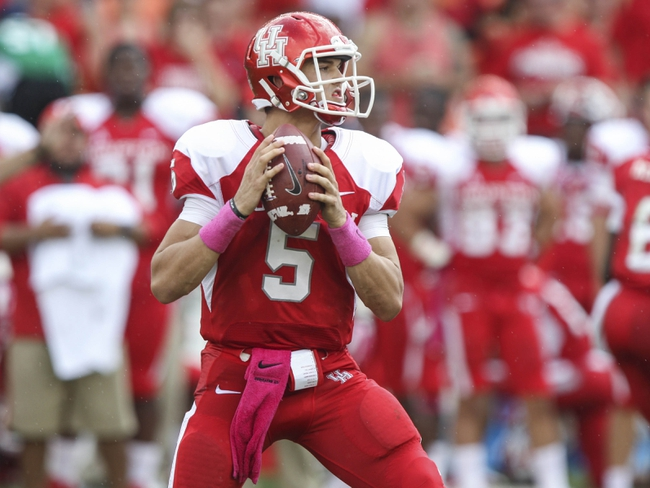 Oct 12, 2013; Houston, TX, USA; Houston Cougars quarterback John O'Korn (5) looks for an open receiver during the third quarter against the Memphis Tigers at BBVA Compass Stadium. The Cougars defeated the Tigers 25-15. Mandatory Credit: Troy Taormina-USA TODAY Sports