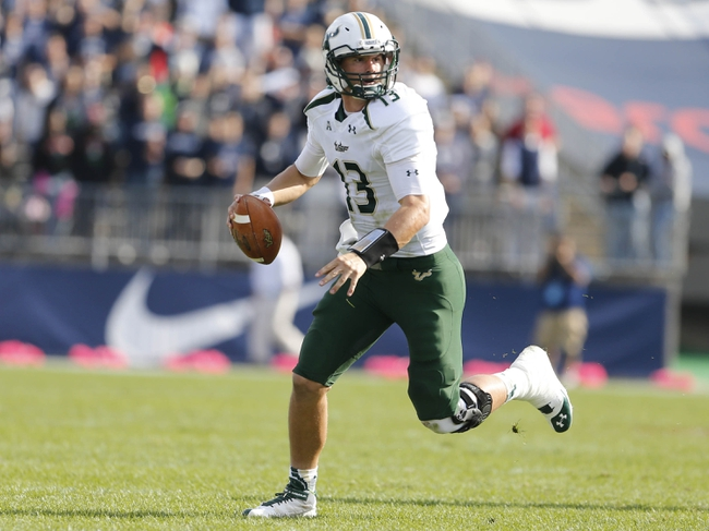 Oct 12, 2013; East Hartford, CT, USA; South Florida Bulls quarterback Bobby Eveld (13) looks for an open receiver against the Connecticut Huskies in the second half at Rentschler Field. South Florida defeated Connecticut 13-10. Mandatory Credit: David Butler II-USA TODAY Sports