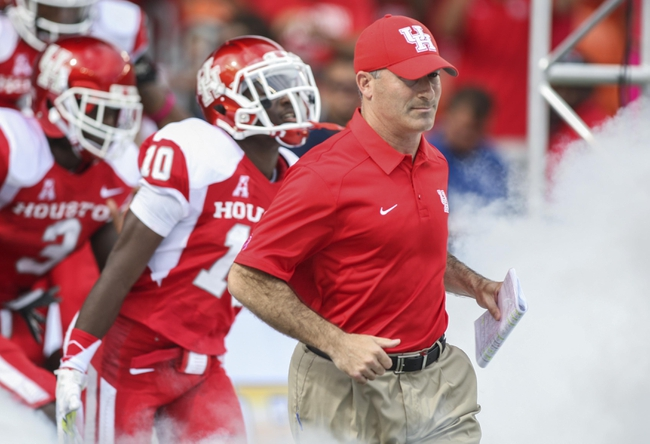 Oct 12, 2013; Houston, TX, USA; Houston Cougars head coach Tony Levine runs onto the field before a game against the Memphis Tigers at BBVA Compass Stadium. Mandatory Credit: Troy Taormina-USA TODAY Sports