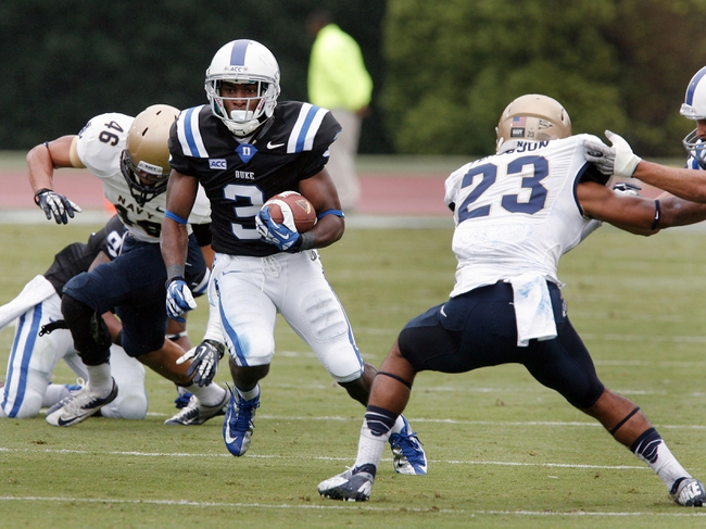 Oct 12, 2013; Durham, NC, USA; Duke Blue Devils wide receiver Jamison Crowder (3) runs with the ball against the Navy Midshipmen at Wallace Wade Stadium. Mandatory Credit: Mark Dolejs-USA TODAY Sports