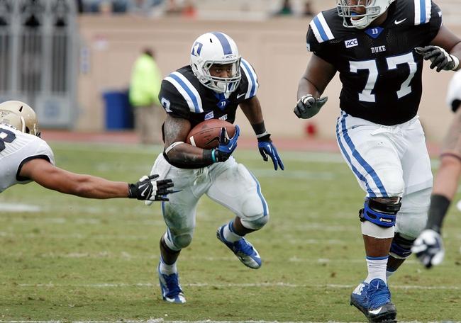 Oct 12, 2013; Durham, NC, USA; Duke Blue Devils running back Josh Snead (9) runs against the Navy Midshipmen at Wallace Wade Stadium. Mandatory Credit: Mark Dolejs-USA TODAY Sports
