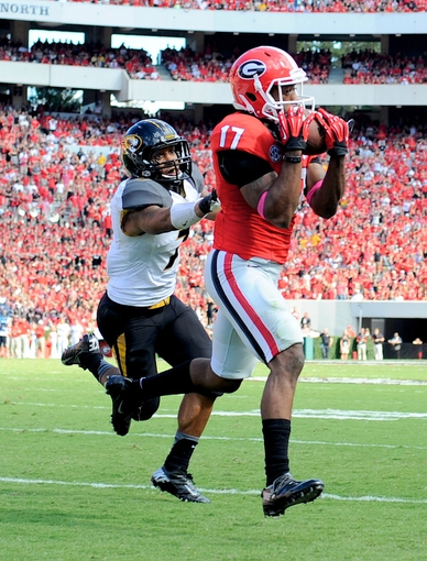 Oct 12, 2013; Athens, GA, USA; Georgia Bulldogs wide receiver Rantavious Wooten (17) catches a touchdown behind Missouri Tigers defensive back Randy Ponder (7) during the second half at Sanford Stadium. Missouri defeated Georgia 41-26. Mandatory Credit: Dale Zanine-USA TODAY Sports