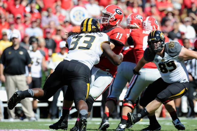 Oct 12, 2013; Athens, GA, USA; Georgia Bulldogs quarterback Aaron Murray (11) is sacked by Missouri Tigers defensive lineman Markus Golden (33) during the second half at Sanford Stadium. Missouri defeated Georgia 41-26. Mandatory Credit: Dale Zanine-USA TODAY Sports