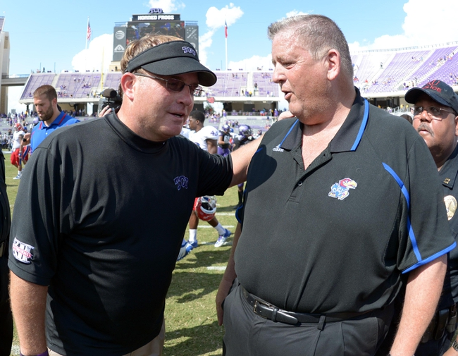 Oct 12, 2013; Fort Worth, TX, USA; TCU Horned Frogs coach Gary Patterson (left) and Kansas Jayhawks coach Charlie Weis shake hands at the end of the game at Amon G. Carter Stadium. TCU defeated Kansas 27-17. Mandatory Credit: Kirby Lee-USA TODAY Sports