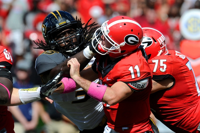 Oct 12, 2013; Athens, GA, USA; Missouri Tigers defensive lineman Markus Golden (33) hits Georgia Bulldogs quarterback Aaron Murray (11) as he releases the ball during the second half at Sanford Stadium. Missouri defeated Georgia 41-26. Mandatory Credit: Dale Zanine-USA TODAY Sports