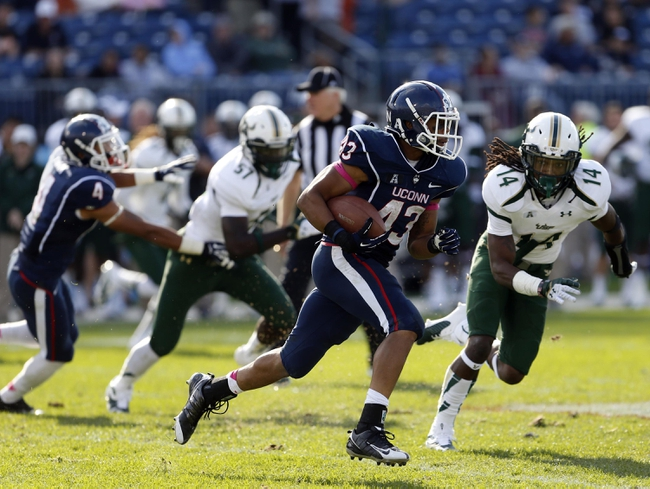 Oct 12, 2013; East Hartford, CT, USA; Connecticut Huskies running back Lyle McCombs (43) runs the ball against he South Florida Bulls in the second half at Rentschler Field. South Florida defeated Connecticut 13-10. Mandatory Credit: David Butler II-USA TODAY Sports