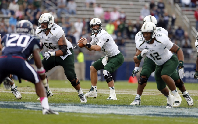 Oct 12, 2013; East Hartford, CT, USA; South Florida Bulls quarterback Bobby Eveld (13) takes the snap against the Connecticut Huskies in the second half at Rentschler Field. South Florida defeated Connecticut 13-10. Mandatory Credit: David Butler II-USA TODAY Sports