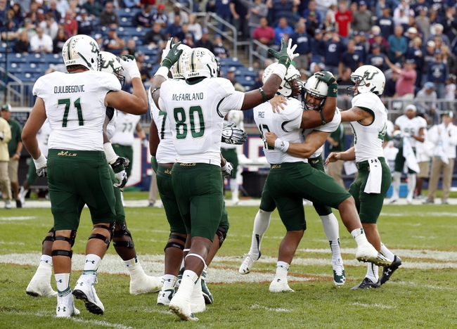 Oct 12, 2013; East Hartford, CT, USA; South Florida Bulls kicker Marvin Kloss (27) is congratulated by his teammates after kicking what would be the game winning field goal against the Connecticut Huskies in the second half at Rentschler Field. South Florida defeated Connecticut 13-10. Mandatory Credit: David Butler II-USA TODAY Sports