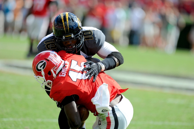 Oct 12, 2013; Athens, GA, USA; Missouri Tigers linebacker Kentrell Brothers (10) tackles Georgia Bulldogs running back J.J. Green (15) during the second half at Sanford Stadium. Missouri defeated Georgia 41-26. Mandatory Credit: Dale Zanine-USA TODAY Sports