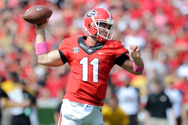 Oct 12, 2013; Athens, GA, USA; Georgia Bulldogs quarterback Aaron Murray (11) throws a touchdown pass against the Missouri Tigers during the second half at Sanford Stadium. Missouri defeated Georgia 41-26. Mandatory Credit: Dale Zanine-USA TODAY Sports