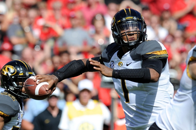 Oct 12, 2013; Athens, GA, USA; Missouri Tigers quarterback James Franklin (1) passes against the Georgia Bulldogs during the second half at Sanford Stadium. Missouri defeated Georgia 41-26. Mandatory Credit: Dale Zanine-USA TODAY Sports