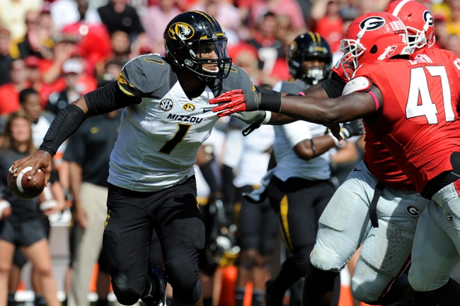 Oct 12, 2013; Athens, GA, USA; Missouri Tigers quarterback James Franklin (1) tries to avoid Georgia Bulldogs defensive end Ray Drew (47) during the second half at Sanford Stadium. Missouri defeated Georgia 41-26. Mandatory Credit: Dale Zanine-USA TODAY Sports